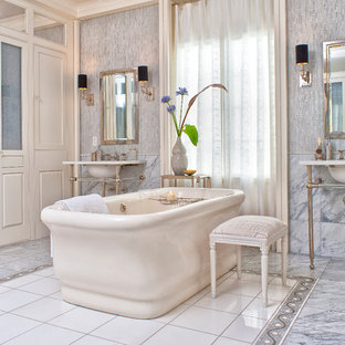 Freestanding bathtub - traditional freestanding bathtub idea in DC Metro with a console sink