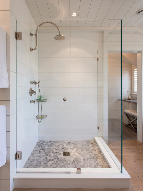 Large Beach Style Master Corner Shower Idea In Boston With A Freestanding  Tub, White Tile