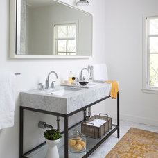 Farmhouse Bathroom by Texas Construction Company