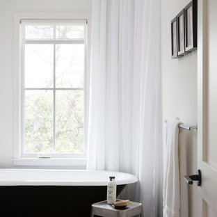 Example of a danish 3/4 porcelain tile bathroom design in Austin with marble countertops and a one-piece toilet