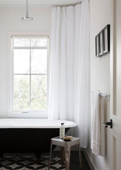 Scandinavian Bathroom by Texas Construction Company
