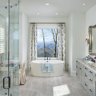 Example of a classic master gray tile and ceramic tile ceramic floor and gray floor bathroom design in Other with gray cabinets, an undermount sink, granite countertops, white walls, recessed-panel cabinets and a hinged shower door
