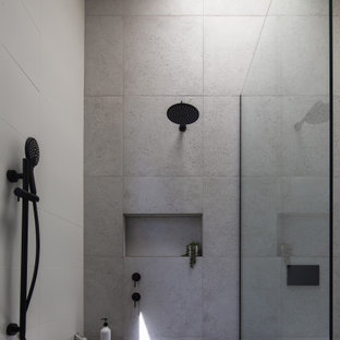 Design ideas for a contemporary bathroom in Melbourne with gray tile and grey floor.