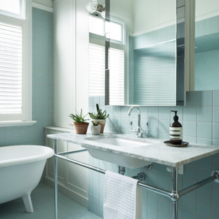 Inspiration for an expansive transitional master bathroom in Melbourne with marble benchtops, a single vanity and a freestanding vanity.