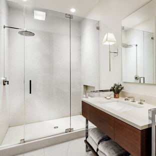 Eclectic white tile alcove shower photo in New York with an undermount sink, flat-panel cabinets and dark wood cabinets