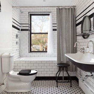 Bathroom - mid-sized industrial master white tile and subway tile mosaic tile floor and white floor bathroom idea in New York with a two-piece toilet, white walls and a trough sink