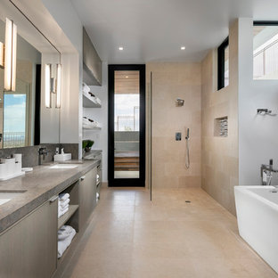 Example of a trendy master matchstick tile beige floor bathroom design in Las Vegas with flat-panel cabinets, gray cabinets, white walls, an undermount sink and gray countertops