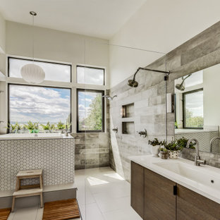 Large trendy master gray tile and wood-look tile ceramic tile, white floor and double-sink bathroom photo in Seattle with flat-panel cabinets, white walls, a trough sink, quartz countertops, white countertops and a floating vanity