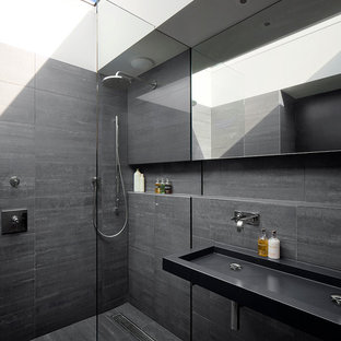 Contemporary shower room in London with a trough sink, a built-in shower, grey tiles and grey walls.