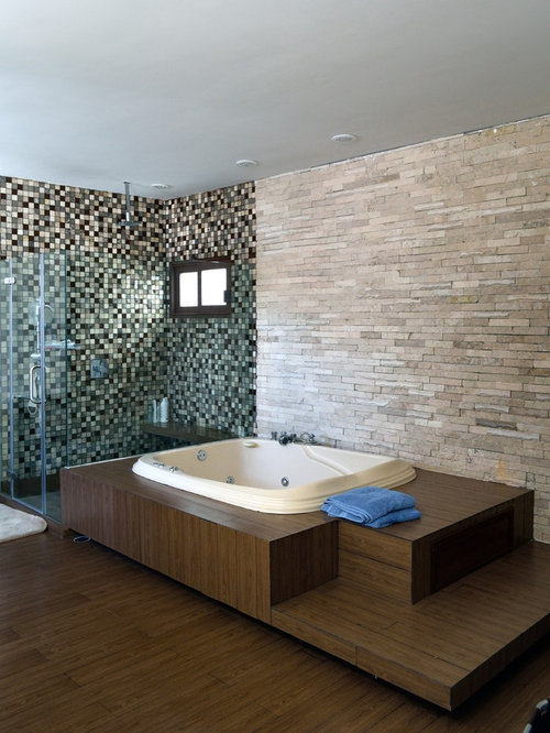 ... Ideas, Remodels & Photos with a Hot Tub and Glass-Front Cabinets