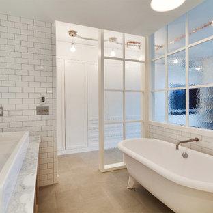 Идея дизайна: главная ванная комната среднего размера в стиле лофт с плоскими фасадами, светлыми деревянными фасадами, ванной на ножках, унитазом-моноблоком, плиткой кабанчик, белыми стенами, полом из известняка, настольной раковиной и мраморной столешницей