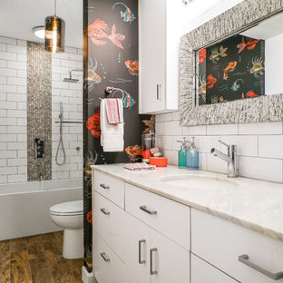 Bathroom - contemporary white tile and ceramic tile dark wood floor and brown floor bathroom idea in Jacksonville with flat-panel cabinets, white cabinets, multicolored walls, an undermount sink and white countertops