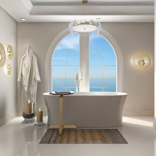Large beach style master beige floor, single-sink and tray ceiling bathroom photo with furniture-like cabinets, light wood cabinets, a one-piece toilet, gray walls, an integrated sink, quartzite countertops, beige countertops and a floating vanity
