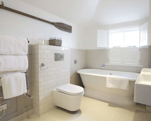 Nautical Ensuite Bathroom In Cornwall With A Freestanding Bath, A Wall  Mounted Toilet, Grey