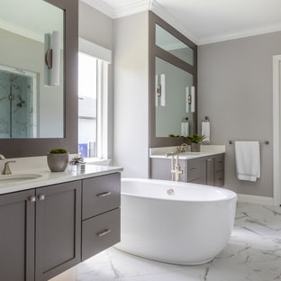 Example of a transitional white floor and double-sink freestanding bathtub design in Jacksonville with shaker cabinets, gray cabinets, gray walls, an undermount sink, white countertops and a floating vanity