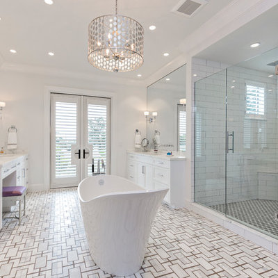 Large transitional master white tile and ceramic tile mosaic tile floor freestanding bathtub photo in Miami with white cabinets, white walls, an undermount sink, marble countertops, a hinged shower door and white countertops