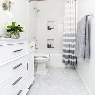 Bathroom - transitional white tile white floor bathroom idea in San Diego with beaded inset cabinets, white cabinets, a two-piece toilet, white walls and gray countertops