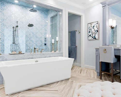 Inspiration for a mid-sized beach style master blue tile and ceramic tile  porcelain floor