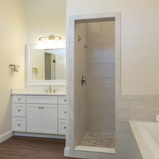 Inspiration for a mid-sized transitional master gray tile and porcelain tile dark wood floor bathroom remodel in Tampa with shaker cabinets, white cabinets, an undermount sink, engineered quartz countertops, a one-piece toilet and gray walls
