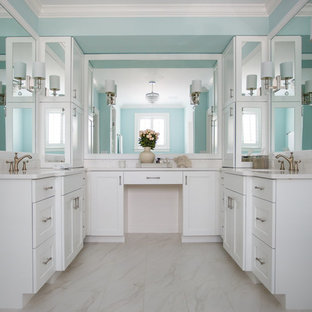 Example of a large coastal master ceramic floor and white floor freestanding bathtub design in Jacksonville with blue walls, shaker cabinets, white cabinets, an undermount sink and engineered quartz countertops