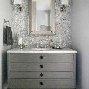 Inspiration for a small transitional 3/4 gray tile, white tile and glass tile white floor bathroom remodel in Jacksonville with flat-panel cabinets, gray cabinets, gray walls, an undermount sink and marble countertops