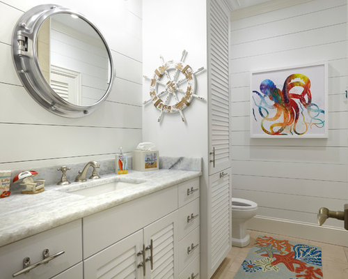 coastal kids bathroom photo in other with louvered cabinets white cabinets white walls