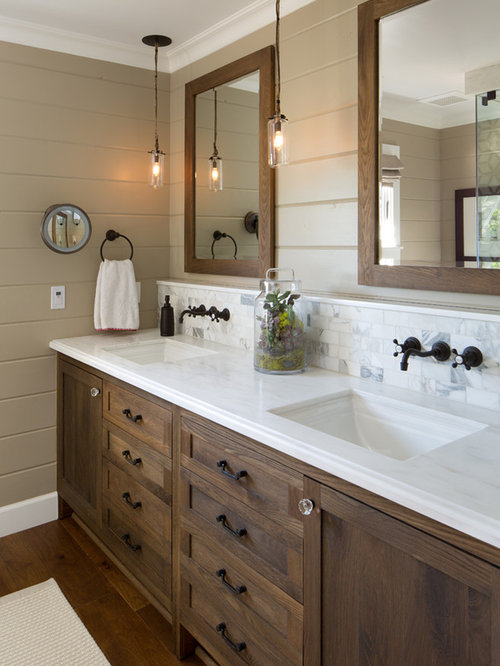 Farmhouse white tile and stone tile bathroom idea in San Diego with dark  wood cabinets and