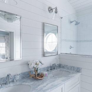 ボストンの中サイズのトランジショナルスタイルのおしゃれなマスターバスルーム (インセット扉のキャビネット、白いキャビネット、アルコーブ型シャワー、分離型トイレ、白いタイル、磁器タイル、白い壁、磁器タイルの床、アンダーカウンター洗面器、珪岩の洗面台、白い床、開き戸のシャワー、青い洗面カウンター) の写真