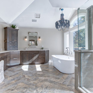 Example of a huge beach style master multicolored tile and glass tile ceramic tile bathroom design in Denver with louvered cabinets, medium tone wood cabinets, a two-piece toilet, beige walls, an undermount sink and quartz countertops