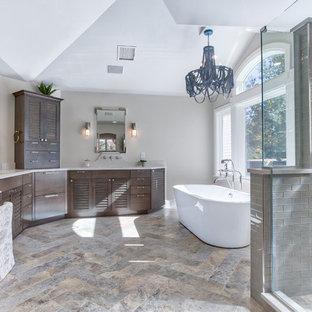 Inspiration pour une très grand salle de bain principale marine avec un placard à porte persienne, des portes de placard en bois brun, une baignoire indépendante, une douche d'angle, un WC séparé, un carrelage multicolore, un carrelage en pâte de verre, un mur beige, un sol en carrelage de céramique, un lavabo encastré et un plan de toilette en quartz modifié.