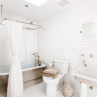 Inspiration for a large shabby-chic style white tile and ceramic tile ceramic floor bathroom remodel in New York with a trough sink, flat-panel cabinets, a two-piece toilet and white walls