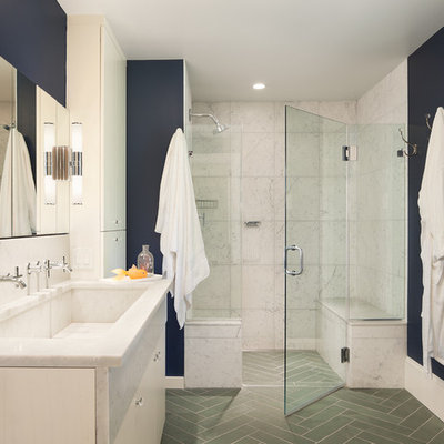 Elegant white tile gray floor alcove shower photo in Philadelphia with a trough sink, white cabinets, blue walls and a hinged shower door