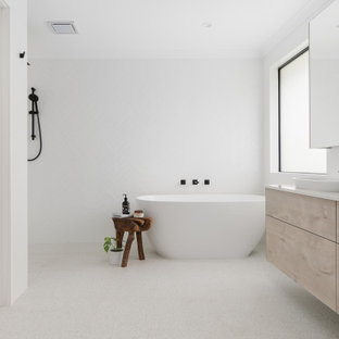 Design ideas for a mid-sized scandinavian master bathroom in Perth with light wood cabinets, a freestanding tub, white tile, cement tile, white walls, ceramic floors, a vessel sink, engineered quartz benchtops, grey floor, an open shower, white benchtops, a double vanity, a floating vanity, flat-panel cabinets and a curbless shower.