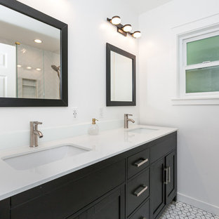 Corner shower - mid-sized modern 3/4 white tile and subway tile porcelain tile and white floor corner shower idea in Los Angeles with beaded inset cabinets, dark wood cabinets, a one-piece toilet, white walls, a drop-in sink, quartz countertops, a hinged shower door and white countertops