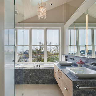 Design ideas for a transitional master bathroom in San Francisco with a vessel sink, cement tile, flat-panel cabinets, medium wood cabinets, a drop-in tub, a corner shower, beige walls, concrete floors and grey benchtops.