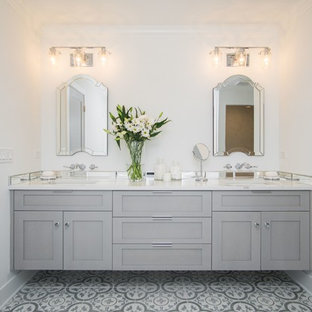 Inspiration for a large farmhouse master mirror tile cement tile floor bathroom remodel in Chicago with shaker cabinets, gray cabinets, a two-piece toilet, white walls, an undermount sink and quartz countertops