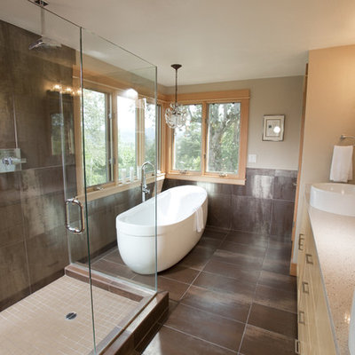 Example of a trendy freestanding bathtub design in Portland with a vessel sink