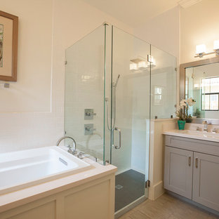 Large transitional master white tile and subway tile medium tone wood floor bathroom photo in Orlando with shaker cabinets, gray cabinets, white walls, an undermount sink and engineered quartz countertops