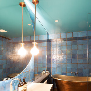 Bathroom - mid-sized contemporary master blue tile and ceramic tile bathroom idea in Melbourne with dark wood cabinets, blue walls and an undermount sink