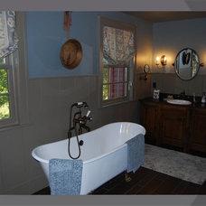 Farmhouse Bathroom by Cutuli Homes