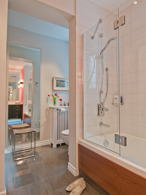 Example Of A Trendy White Tile Tub/shower Combo Design In Montreal
