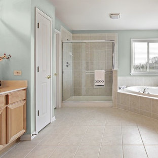 Bathroom - mid-sized contemporary master beige tile and porcelain tile ceramic tile and beige floor bathroom idea in DC Metro with green walls, recessed-panel cabinets, light wood cabinets, laminate countertops and white countertops