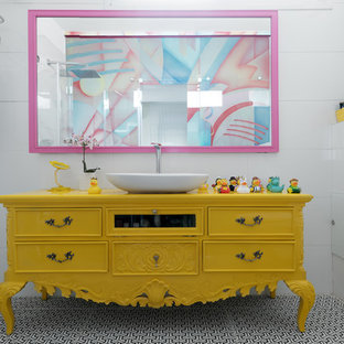 Inspiration for an eclectic white tile multicolored floor bathroom remodel in Tel Aviv with furniture-like cabinets, yellow cabinets, white walls, a vessel sink, wood countertops and yellow countertops