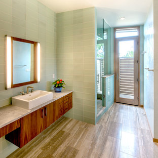 Inspiration for a contemporary green tile and glass tile alcove shower remodel in Denver with a vessel sink, flat-panel cabinets and medium tone wood cabinets