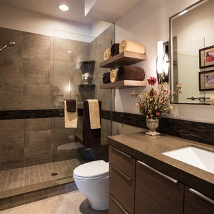 Inspiration for a contemporary bathroom in Denver with porcelain tiles, a submerged sink and brown worktops.