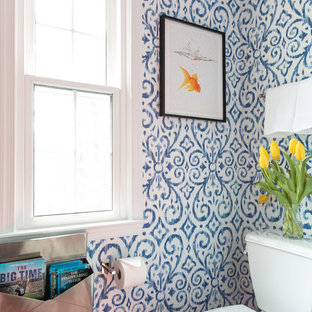 Design ideas for a medium sized world-inspired family bathroom in DC Metro with flat-panel cabinets, dark wood cabinets, an alcove bath, an alcove shower, a two-piece toilet, white tiles, porcelain tiles, blue walls, ceramic flooring, a submerged sink, engineered stone worktops, orange floors, a sliding door and white worktops.