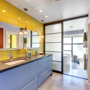 Example of a trendy master yellow tile freestanding bathtub design in San Diego with an undermount sink, flat-panel cabinets and blue cabinets