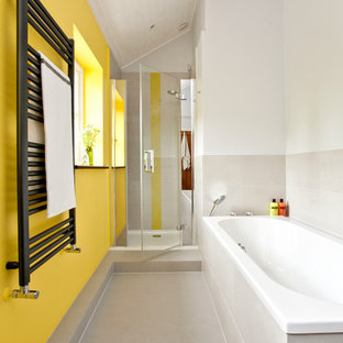 Photo of a contemporary bathroom in Oxfordshire with a built-in bath, an alcove shower and yellow walls.