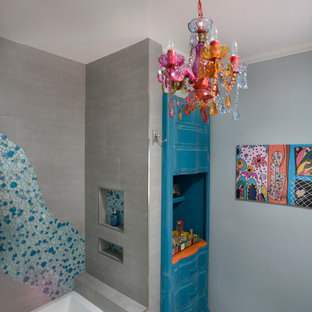 Mid-sized eclectic multicolored tile and mosaic tile ceramic floor alcove bathtub photo in Los Angeles with furniture-like cabinets, distressed cabinets, quartz countertops and gray walls