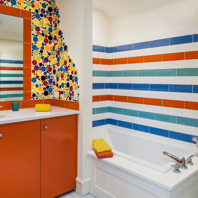 Drop-in bathtub - eclectic kids' multicolored tile, blue tile, orange tile, white tile and ceramic tile drop-in bathtub idea in Philadelphia with flat-panel cabinets, orange cabinets, a one-piece toilet and an undermount sink